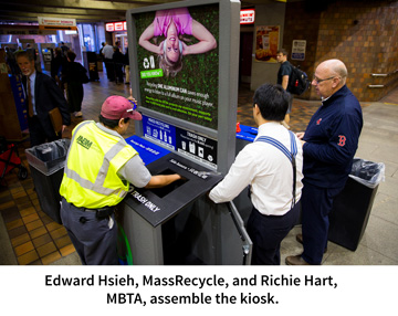 Edward Hsieh, MassRecycle, and Richie Hart, MBTA, assemble the kiosk